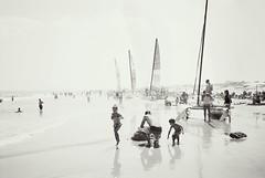 R1-012-4A (David Swift Photography) Tags: davidswiftphotography newjersey oceancitynj catamarans boats childrenplaying atlanticocean jerseyshore ilfordxp2 olympusstylusepic