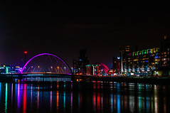 The Clyde Arc and River Clyde (Brian Travelling) Tags: scotland pentax pentaxdal pentaxk20d glasgow riverclyde clydearc squinty bridge finnieston crane arch reflections lights darkness dark night colours water