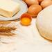 Dough, eggs, butter, wheat spikelets and flour