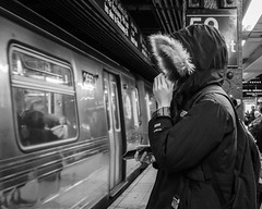 A Face in the Crowd (John St John Photography) Tags: streetphotography candidphotography 59thstreet subwaystation mta newyorkcity newyork commuter hidden face train bw blackandwhite blackwhite blackwhitephotos johnstjohnphotography