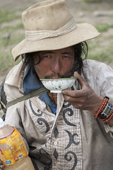 Drinking chang (Jamie @project-himalaya.com) Tags: projecthimalaya 2007 2007shishapangma 2007shishapangmaexpedition canonef70200mmf4lisusm canoneos5d copyrightjamiemcguinness httpprojecthimalayacom shishapangma xizangtibet china
