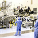 Spacecraft technicians from NASA's Jet Propulsion Laboratory position the multi-mission radioisotope thermoelectric generator (MMRTG) for NASA's Mars Science Laboratory (MSL) mission on the turning fixture above the MMRTG integration cart. Origina