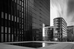 Squareflection (frank_w_aus_l) Tags: glass concrete longexposure dus düsseldorf dusseldorf germany architektur architecture monochrome black blackandwhite noiretblanc white nikon pce 2435 d810 nikkor sky skyline skyscraper
