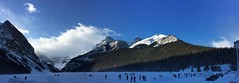 Ice Skating Canada (Mr. Happy Face - Peace :)) Tags: fairmount chateau lakelouise hotel outdoors activities snowcaps mountains sky clouds sun albertabound alberta canada banffparkway scenery landscapes rockies art2019 cans2s skating snow ice strangers 25years celebration twentyfive