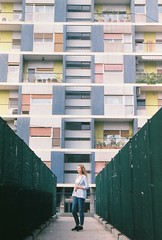 Barrio de Bari (Pavel Kaplunov) Tags: girl bari italy buildings architecture symmetry