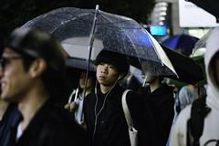 Only happy when it rains (downtownseoul) Tags: japan tokyo shibuya streetphotography street colour night rain umbrella boy guy headphones city urban crowd candid portrait