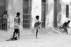 MOZ-Ilha de Mocambique-0703-243-bw2 (anthonyasael) Tags: 5 africa african afrika baseball black boy boys building casual cheerful child children childrenonly colonial cricket dirty door elementaryage enjoy enjoying enjoyment five fivepeople friend friends friendship fulllength fun game girl girls happiness happy ilhademozambique kid kids leisure misbehavior mischief mocambique mozambique mud peel peeled peeling people person play playing railing smile smiling southernafrica standing toothysmile topb untidy mozambiquemocambique moz