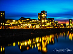 media.harbor.blue.hour (grizzleur) Tags: düsseldorf dusseldorf duesseldorf de blue hour bluehour urban sky water soft drama beautiful reflections reflection light artificial warm night longexposure medienhafen mediaharbor mediaharbour nachtaufnahme nacht romantic blur streaky smooth olympus olylove olympusomdem10mkii olympusm17mmf18 nd filter