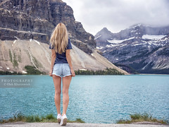 Facing the Bow Lake (Oleh Khavroniuk (Khavronyuk)) Tags: nikon nikkor d750 canada explorecanada explorealberta alberta banff nationalpark national park icefields parkway nature naturaleza naturephotography portrait portraiture retrato longlegs legs shorts sensual sexy stunning candid lady girl woman model posing travel hiking holiday summer lake bowlake mountains mountain mountainside glamour snow water wasser blue waiting view beleza belle beauty beautiful colors colours colorful new digital geotagged gorgeous sizzling postcard hair weather pretty world rockies canadian
