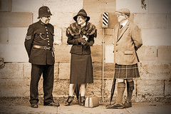 Something To Laugh About. (Cycling Saint) Tags: pickering1940sreenactment wwllreenactmentevent nikond600nikkor7020028vrll 1940sreenactors 1940sreenactmentevent portraits people faces livinghistory vintageevent railwaystation northyorkshire monochrome sepia