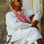 Indian Man in Chair With Cane, Allahabad India thumbnail