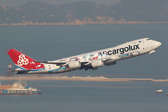LX-VCM, Boeing 747-8F, Cargolux, Hong Kong (ColinParker777) Tags: city luxembourg boeing 747 74f 7478 7478f 748f 74n jumbo freighter freight cargo cargolux cv airplane airliner airline airlines airways departure takeoff hkg vhhh hong kong chek lap kok airport fly flying flight sunny canon 7d 7d2 7dmk2 7dmkii 7dii 200400 l lens zoom telephoto pro plane aviation lxvcm scheme colours colors cutaway reclamation sea