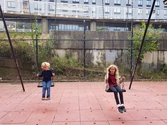 Kids On The Swings At The Bland Playground (Joe Shlabotnik) Tags: swings playground violet queens everett october2018 flushing cameraphone 2018 galaxys9