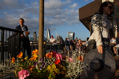 Southbank, London (jaumescar) Tags: london england unitedkingdom flowers hat people street photo streetphotography canpubphoto light nice shard city urban pub man drinking sunset hand
