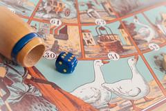Hobby. Board games (inma F) Tags: color lio macro stillife macromondays hogar home casa hobby hobbies entrenetimiento game goose juego oca clasico dado azul blue die