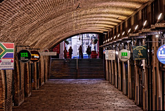 Underneath the Arches (Geoff Henson) Tags: tunnel railwayarch shops signs pedestrian steps people paving lights london vault