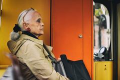 Thinking Orange (Marta Marcato) Tags: orange lady woman oldlady yellow bus tram transport earrings look portrait portraiture people face vienna wien nikond7200 austria