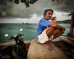wait. (Collin Key) Tags: man ship portait sulawesi people gorontalo smoking texture clouds indonesia coast sea indonesien id