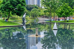 Park with lake in Kuala Lumpur City Centre (KLCC), Malaysia (UweBKK (α 77 on )) Tags: klcc park lake grass trees bushes green water reflection sculpture city centre urban kuala lumpur malaysia southeast asia sony alpha 550 dslr