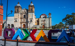 2018 - Mexico - Oaxaca - Templo de Santo Domingo (Ted's photos - Returns late Feb) Tags: 2018 cropped mexico nikon nikond750 nikonfx oaxaca tedmcgrath tedsphotos tedsphotosmexico vignetting oaxacaoaxaca oaxacadejuárez oaxacamexico templodesantodomingo oaxacatemplodesantodomingo templodesantodomingooaxaca temple santodomingo oaxacasantodomingo santodomingooaxaca church churchdome streetscene people peopleandpaths pathsandpeople bluesky blue bollards unesco unescoworldheritagesite