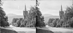 Spire in the woods (National Library of Ireland on The Commons) Tags: thestereopairsphotographcollection lawrencecollection stereographicnegatives jamessimonton frederickhollandmares johnfortunelawrence williammervynlawrence nationallibraryofireland locationidentified clanbrassilbarn tollymore tollymoreforestpark down northernireland ulster tollymorepark tullymorepark tullymore newcastlecountydown countydown barn gothic gate park demesne 2252