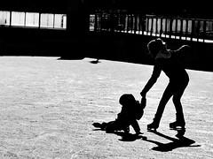 Oops ... (heinzkren) Tags: wien vienna rathaus ice eislaufplatz shadoe silhouette eistanz hoppla schwarzweis blackandwhite be sw monochrome urban sport candid panasonic lumix sun winter wintersport city iceskating people street streetphotography kontrast innamoramento