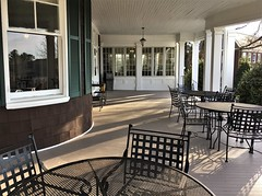 Garrison Forest ~ Manor House porch (karma (Karen)) Tags: garrisonforest owingsmills maryland manorhouse porches chairs tables shadows windows walls reflection hww iphone minimester19