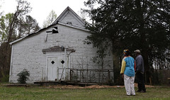 Hillman and Freddie Green look at the dilapidated, abandoned St. Paul's AME Church.