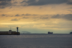 Winter Sunset (panos_adgr) Tags: nikon d7200 piraeus commercial harbour attica greece telephoto landscape photography seascape sunset clouds winter sky sea water horizon dock ship lighthouse handheld