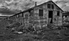 Lonely (arbyreed) Tags: arbyreed old abandoned forgotten wooden barracks armyaircorpswendover wendoverbaseutah b17 b29 atomicbomb enolagayb29bomber wwii monochrome bw blackandwhite dark