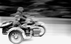 Motorcycle panning (rentavet) Tags: analog canoneos10s agfacopexhdp13 microfilm 50mm conneautohio rodinalsemistanddevelopment1200 ddayconneaut reenactment