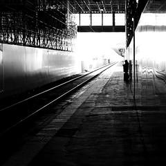 Against the fence (pascalcolin1) Tags: paris13 femme woman gare station austerlitz palissade fence lumière light ombre shadow rails photoderue streetview urbanarte noiretblanc blackandwhite photopascalcolin 50mm canon50mm canon