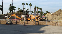(Rich T. Par) Tags: pomona phillipsranch socal southerncalifornia losangelescounty lacounty constructionsite constructionvehicles california suburb sky field tractor dirt fence civilengineering parkinglot heavyequipment backhoe backhoeloader loaderbackhoe digger bricks brickwall chainlinkfence