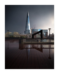 Storm, Light, Shard (Dave Fieldhouse Photography) Tags: theshard shard londonbridge londonbridgehospital london england city cityscape citycentre capital skyscraper sky tower stairs staircase reflections rain pavement tiles sculpture moody light storm lampost person fujifilm fuji fujixt2 fujinon816mmf28 wwwdavefieldhousephotographycom streetphotography street glass