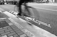 Fast bike (Manuel Goncalves) Tags: japan kodaktmax400 nikonn90s nikkor28mm blackandwhite analogue 35mmfilm tokyo street road bike