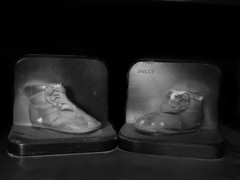 Low Light Challenge 1 (Corgibird) Tags: lowkey lowlight antique babyshoes branzeshoes bronze blackandwhite bw bronzeshoes grandmothers oldthings spotlight indoors bookends heirloom familyheirloom history ancestors