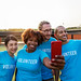 Diverse volunteers taking a selfie together