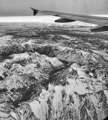 Wing view (Jim Nix / Nomadic Pursuits) Tags: iphone skylum monochrome airplane aerial mountains winter snow blackwhite iphone7plus luminar travel jimnix