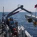 Sailors aboard the USS Pioneer deploy a tow body 36 over the side as the ship conducts a mine hunting training exercise