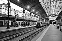 Train station (Roi.C) Tags: train standing walking running station man people europe portugal outdoor outside candid monochrome black white bw light bright composition framing nikkor nikon april 2018 frame view shot sharp photo photograph camera travel trip d5300 photography street capital urban ligh monotone trainstation porto building 18140mm