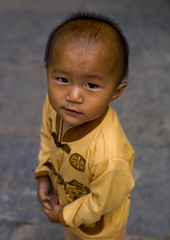 Kid In Tuan Shan Village, Yunnan Province, China (Eric Lafforgue) Tags: 23years a0006359 asia china colorpicture frontview lookingatcamera oneboyonly onepeople oneperson realpeople tuanshan vertical waistup yunnan yunnanprovince