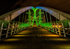To the other side (peterwilson71) Tags: arcitecture arch bridge buildings clouds cityscape dark downtown exposure evening green industrial sky light landscape longexposure lights outdoors overpass reflections riverside travel view water