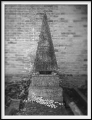 obelisk with feet (Andrew C Wallace) Tags: cemetaryofsaintmicheleinisolation venice venezia italy italia cemetery graveyard obelisk egypt blackandwhite bw infrared ir microfourthirds m43 olympusomdem5mk2 thephotontrap