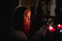 Remember (jameswilkinson1) Tags: 50mm leica france paris notredame travel streetphotography reflecting thoughts candle light church girl remember