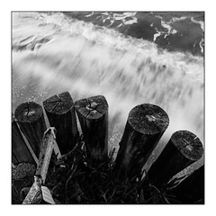 Receding wave (Wilco1954) Tags: corse france leicaq beach postprocessing receedingwaves blackandwhite mono slowexposure corsica posts saintflorent movement