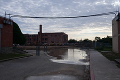 (danielhast) Tags: houston texas sky clouds water puddle powerlines building school construction