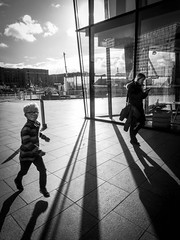 Mobile Orphan (stephenbryan825) Tags: liverpool mannisland merseyside angles backlighting boy building dramaticlight floor graphic ground intothelight lines mother parent pavement people playing running selects shadows wideangle woman