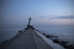 Ludington Lighthouse After Sunset (DJ Wolfman) Tags: ludington ludingtonmi michigan michiganlighthouses michiganfavorites blue bluesky water lakemichigan lake pier lighthouse sky clouds sunset pink olympus olympuspenf penf zuiko 25mmf12zuiko zd