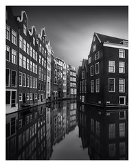 The Canal Houses [on explore] (Marco Maljaars) Tags: longexposure le house houses monochrome marcomaljaars blackandwhite bw mood serenity canon 70d sky light water city cityscape amsterdam canal old architecture building