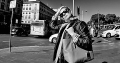 Should I stay or should I go. (Baz 120) Tags: candid candidstreet candidportrait city candidface contrast street streetphotography streetphoto streetportrait strangers rome roma europe women monochrome monotone mono noiretblanc bw blackandwhite urban life portrait people italy italia omd grittystreetphotography faces decisivemoment
